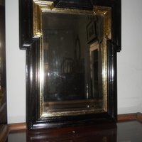 Black polish and guilded art-deco mirror . 56 cm hi , 45 cm wide